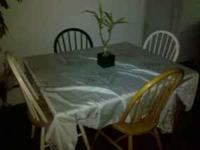 I am selling a beautiful dinning table w/ chairs with