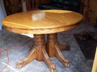 this is a high Quality Oak table with 4- 10 inch leafs,