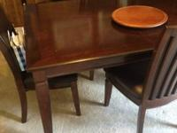 Dinning room table for sale with four padded chairs one