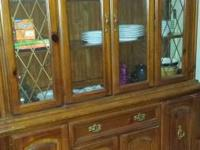 Must sale dinning room table and hutch with 6 chairs.