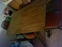 I have a dinning room table with 4 chairs i need out of
