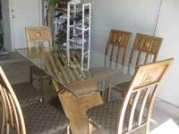 Beautiful dinning set, six chairs, glass top. Like new.