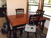 Nice dinning table with 4 chairs and leaf. solid wood 2