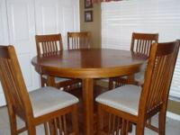 Tall Pub style table with six chairs. It has an