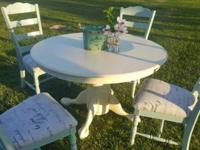 Beautiful dinning table with four chairs refinished to