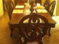 I am selling this like new Dinning table with hutch it