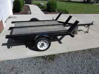 "* This is a dirt bike trailer with three ""rails"" to"