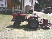 "Great running diseal mower tractor has a 36"" woods"