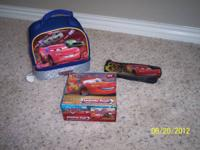 I have 1 Cars pencil case, a Cars lunch box, and a Cars