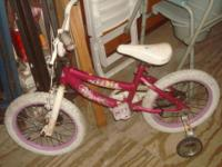 This little girls' bike is bright Pink with Walt Disney