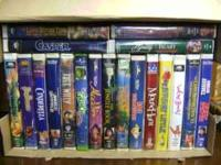A box full of Disney VHS movies for sale, all play
