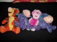 Disney's Winnie the Pooh stuffed animals for sale.