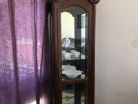 Display cabinet. Dark wood , mirrored back , glass