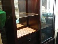 Two unit display with glass sliding door. Storage