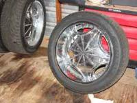 """This is a set of 22"""" rims & tires off a 2004 dodge 1500"""