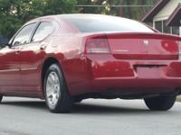 Red Dodge Charger for sale. ($4995) Year 2007 and has a