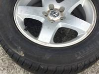 Charger wheels with pirelli p4  215/65/17 with 80%