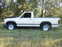 87 dodge dakota. pump gas 406 small block chevy.