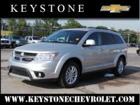 This silver 2013 Dodge Journey SXT might be just the