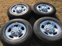 "Four Dodge OEM 8 Lug 17"" wheels and tires. This set"