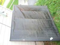 For sale is a black tonneau cover for a short bed, full