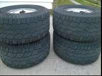 Dodge ram 2500 wheels and tires 285x75r16 the rims are
