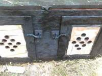 This dog box is homemade. It is made well though and