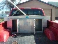 A dog box for truck bed. It will fit in a long or short
