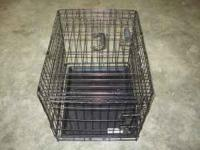 "24""x19""x21"" cage for a 15 to 16 pound pet Call  opens"