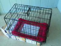 Dog Crate With bedding has 2 doors Size 22 long 13 wide
