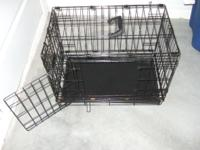Black wire dog training crate in good condition (22