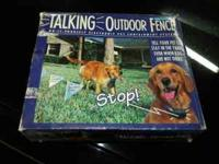 DOG OUTDOOR FENCE NEW IN BOX NEVER USED. COMES WITH