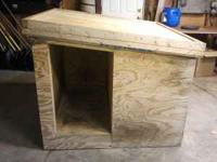 Wooden dog house for sale. It is double walled with