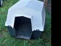 LARGE plastic dog house is in good condition, is