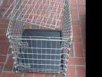 "Dog Training Cage Measures 24""w x 20""d x 21""h We have a"