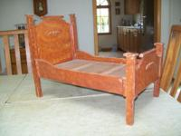 "Wooden doll bed, measures 15"" high, 11"" wide, and 20"""