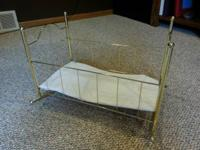 Brass looking doll cradle - used, but still in ok