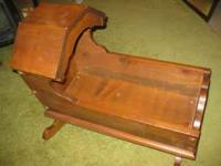 "nice wooden doll cradle. 22""long 12""wide $20 phone"