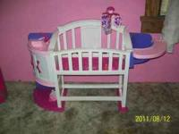 Doll crib w/highchair, and sink w/cabinet on sides.
