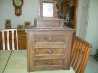 3 drawer dark wood antique doll dresser with mirror.