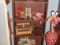 Lots of pieces of doll furnishings for little dolls up