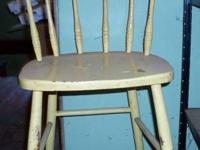 A vintage high chair painted yellow, but needs