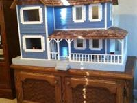 Beautiful dollhouse with LOTS of expensive furniture.