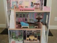 Doll House with Furniture in Good Condition.  If