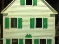 Hand made all wood doll house with individually cut
