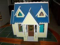 This wooden doll house and the furniture was all