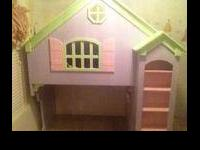 Very cute Doll House Loft bed.... Twin bed on top