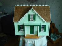 Beautiful crafted wood doll house that was loving