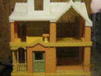 Old dollhouse from 1990's Comes with house, porch,