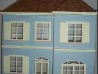 Dollhouse for sale in the French La Maisonnette style.